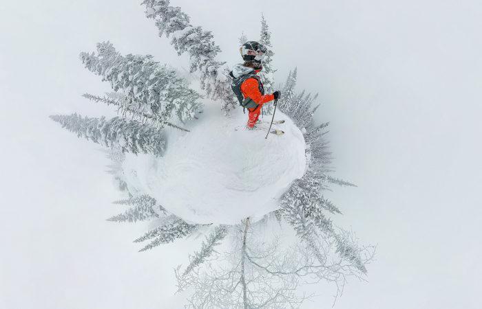 Skier on a mountain pick in Baikalsk