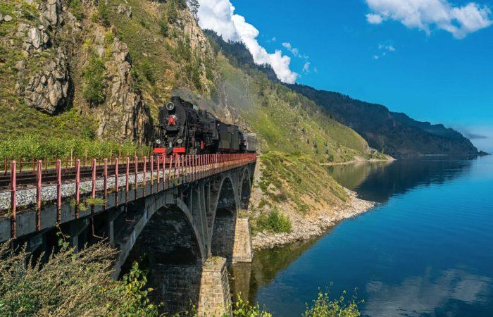Circum Baikal railway train on the bridge summer tour