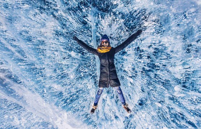 girl lies on Baikal gas bubble ice