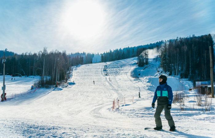 Man on a snowboard in Baikalsk mountain